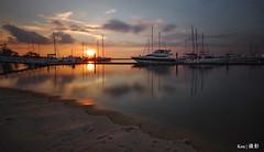 Batam Sunset (Ken Goh thanks for 2 Million views) Tags: nongsa resort beach boats sunset golden sun blue sky reflection water moving clouds smooth silhouette pentax k1 sigma 1020
