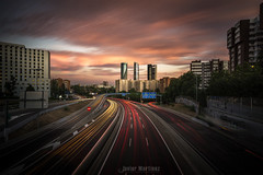Hora punta (Javier Martnez Morn) Tags: skyline madrid edificios edificio rascacielos skyscraper light trail lights rush hour clouds nubes sunset atardecer largaexposicin lon exposure sonyalpha a6000 jmartinez76 jmartinez javier martinez moran castellana ocaso colores vacio