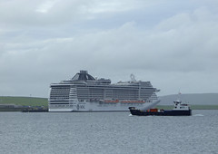Little And Large (orquil) Tags: littleandlarge contrasting sizes foregroundshapinsay compact small roro ferry orkneyferries underway background msc splendida mscyachtclub huge enormous cruiseship liner 4363passengercapacity 137936tons moored alongside hatstonpier kirkwallbayseasideshorelinecalmseaaugustafternoonsummerorkneyislandsscotlandukunited kingdomgreat britain orcades maritime interesting unusual eyecatching memorable foreground shapinsay