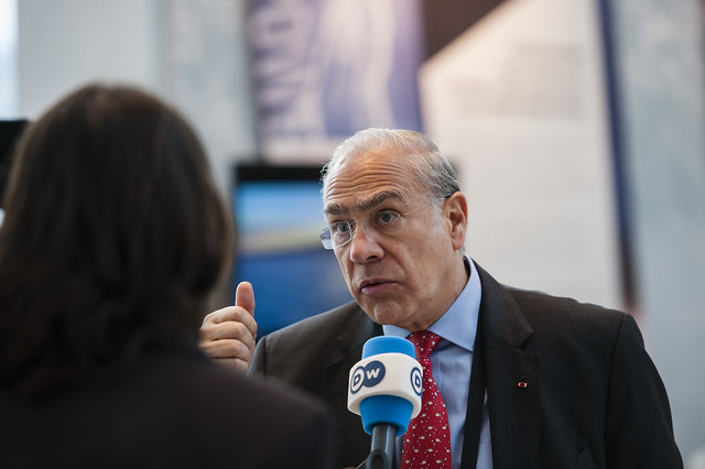 Angel Gurría with the media