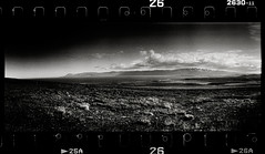 The Valley (tsiklonaut) Tags: travel sky panorama white black film blanco clouds analog 35mm dark landscape island iceland highlands y drum scanner pano centre horizon negro central grain dramatic panoramic scan dreaming arctic valley experience 400 roll dreamy analogue 135 grainy unreal agfa volcanic apx grounds org mystic 202 analogica discover mustvalge drumscan ufg analoog pmt panoraam maastik ethol photomultipliertube arktiline