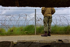Once a Soldier (Eric Luesink) Tags: ocean old 6 france grass june stone fence soldier wire sand war uniform gun legs boots wwii bunker german american barbed normandy 1944