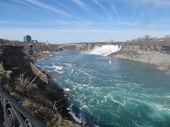 Niagara. The Rainbow Bridge and the Bridal and American Falls from near the Horseshoe Falls Canadian lookout. (denisbin) Tags: people niagarafalls tourists horseshoefalls americanfalls caveofwinds