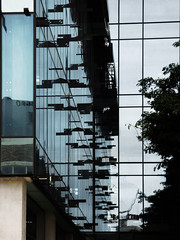 Modern Architecture or a Modern Mistake (Steve Taylor (Photography)) Tags: art architecture design building column window black blue white glass metal concrete newzealand nz southisland canterbury christchurch cbd city tree reflection scaffold scaffolding