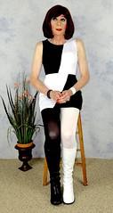 DSC05524 (msdaphnethos) Tags: white black tv jester boots cd tgirl transgender transvestite hosiery gogo brunette crossdresser crossdress nylons minidress daphnethomas
