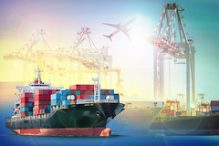 Logistics and transportation Container Cargo ship and Cargo plane with working crane bridge in shipyard background, logistic import export background and transport industry. (drakonenterprises) Tags: airplaneboatbridgebrightbusinesscargocolorfulcommercecommercialcontainercranecustomsdeliveryeconomyenvironmentexportexpressfreightfreighterglobalgoodsharborheavyimportindustrialindustryinternationallar airplane boat bridge bright business cargo colorful commerce commercial container crane customs delivery economy environment export express freight freighter global goods harbor heavy import industrial industry international large load logistic maritime merchandise nautical ocean pier plane port sailing sea ship shipment shipping structure tanker technology trade transfer transport transportation vessel thailand