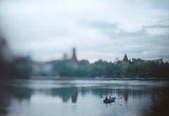 In a boat (vetpht) Tags: city reflections 50mm cityscape moscow olympus zenit manual waterscape tiltshift  izmailovo