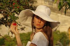Natalya Hrebionka (Natali Antonovich) Tags: portrait versailles france lifestyle natalyahrebionka hat hats blossom poetessnatalyahrebionka hatisalwaysfashionable style charm fromfamilyalbum familyarchive louisxiv sunking harmony park louislevau time sun synthesis stare flowers