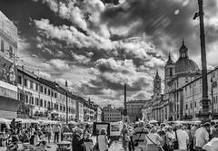 Piazza Navona, Rome (Alan-S2011) Tags: piazzanavona rome italy fountain fiumi fontana del nettuno fontanadelnettuno blackandwhite bw clouds sky crowds crowd people sunrays