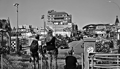 Stopping to enjoy the (Coney) view (Robert S. Photography) Tags: people overlooking cityscape fromabove boardwalk street coneyisland amusmentpark buildings shops billboards nathans cars subway summer sunshine streetcrossing steps bw brooklyn newyork canon powershot elph160 iso100 september 2016
