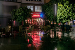 BearbeitetKleinCamino- (Peter Hauri) Tags: light water rain night reflections switzerland lowlight cityscapes available reflextions