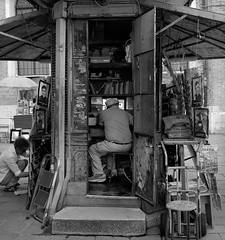Newsstand, Venice, Italy (austin granger) Tags: venice italy news film work booth square box geometry newspapers books newsstand priests gf670