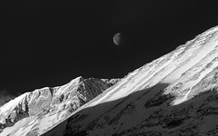 (CareyCloss) Tags: alberta blackandwhite bw banff blackwhite canada canadianrockies calm dramatic dawn daybreak formations highcontrast celestial canmore kananaskiscountry landscape monochrome mountain mtrundle moon nature nikon outdoors d7000 rockies snow snowcovered peak halfmoon textures winterscape
