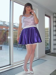 Shy girl (Paula Satijn) Tags: hot sexy stockings girl smile happy pumps highheels purple legs sweet silk adorable skirt tgirl transvestite heels satin miniskirt gurl silky