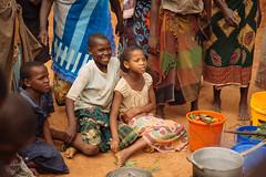 Malawi Village Children Watching a Meal Being Prepared (IFPRI-IMAGES) Tags: eastafrica smallholderfarms ifpri farm agriculture malawi lilongwe child children laugh fun smile happy watch spectator witness generations villager village cookstove cook stove boil pot meal prep prepare smallholder matron africa girl boy nsima maizeflour