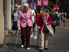 In The Pink (Leanne Boulton) Tags: urban street candid portrait streetphotography candidstreetphotography streetlife woman women old age aged elderly pensioner face faces facial expression walking stick mobility bright pink colourful colorful tone texture detail depth natural outdoor light sunlight shade shadow city scene human life living humanity people society culture canon 7d color colour glasgow scotland uk