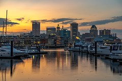 Boats, in the Harbor (Isaac Guerrero) Tags: landscape skyline reflection boats harbor water sunset cityscape city baltimore