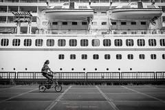Riding through (farflungistan) Tags: amsterdamoost canon7d photowalk summer2016 amsterdam holland nederland netherlands docks biker photobomb