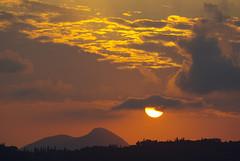LGKR SUNSET (GEORGE TSIMTSIMIS) Tags: sunset orange sun mountain yellow clouds landscape shadows greece land corfu figures kerkira