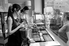 Chinatown (sgreen757) Tags: fuji fujifilm x30 black white street photography chinatown soho london people bakery fish cake machine window shop