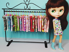 Anouk eyes up a rack of $20 vintage-inspired dresses (now on Etsy!)