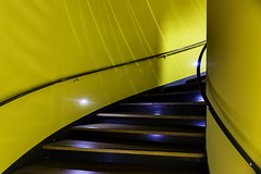 Yellow descent (Maerten Prins) Tags: light shadow abstract color colour netherlands lamp lines yellow wall stairs campus spiral university shadows library curves nederland eindhoven minimal line staircase minimalism curve bibliotheek tue