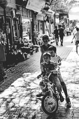 "Still ""alive"" (Emre .) Tags: red documentary documentinglife blackandwhite blackwhite bnw street streetphotography streetportrait kids fun bike belgesel sokak kemeralt basmane izmir d7100 nikon"