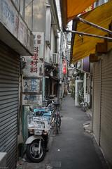 alley (kasa51) Tags: sign japan typography tokyo alley motorbike kanji narrowstreet gnautonikkor45mmf28