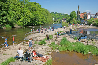 People enjoying the river Dee at Llangollen, North Wales.