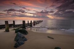 Hopton-on-Sea Groyne Sunrise (John__Hull) Tags: sea sunrise groyne hopton on clouds red sand beach seascape east coast norfolk wood structure summer england nikon d3200 sigma 1020mm rocks granite waves