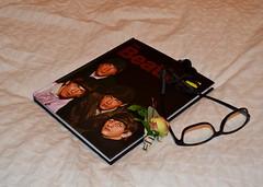 The Beatles (Vinny Gragg) Tags: glasses book books beatles thebeatles rockandrollhalloffame rockrollhalloffame halloffame hof seattle washington seattlewashington johnlennon paulmccartney georgeharrison ringostarr ringo flower flowers