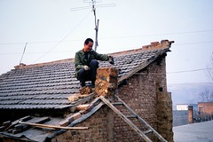 New chimney for the house (Frhtau) Tags: china  peoples republic  countryside scenery man repair chimney kamin brick ziegel roof dach hand made work village dorf farm farmer tv asia asian east people leute daily live antenna building