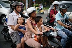 a whole family story (grapfapan) Tags: saigon hochiminhcity street traffic people family candid motorbike scooter vietnam