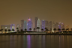 Doha by night... (John Konstandis) Tags: qatar doha tower qatartowers skyscraper palmtrees water sea seacoast night nightphotography longexposurephotography landscape lights canoneos5dmarkiii canonef24105mmf4lisusm