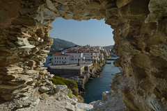 A Glimpse of Andros (billpeppasphotography) Tags: greece andros chora cyclades kyklades island mediterranean aegean hellas ruins wwii town city village hole view sea ocean rock rocky rocks sky glimpse sailor unknown