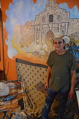 Tye putting the finishing touches on the Alamo (radargeek) Tags: route66 shamrock tx texas tye painting bigvernssteakhouse mural art artist alamo cowboyhat painter thehumanfamily